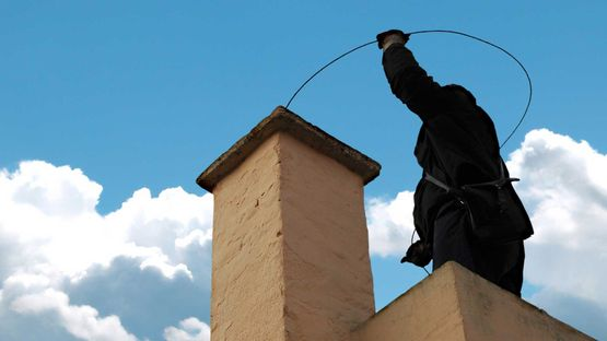 Chimney sweeping work being carried out